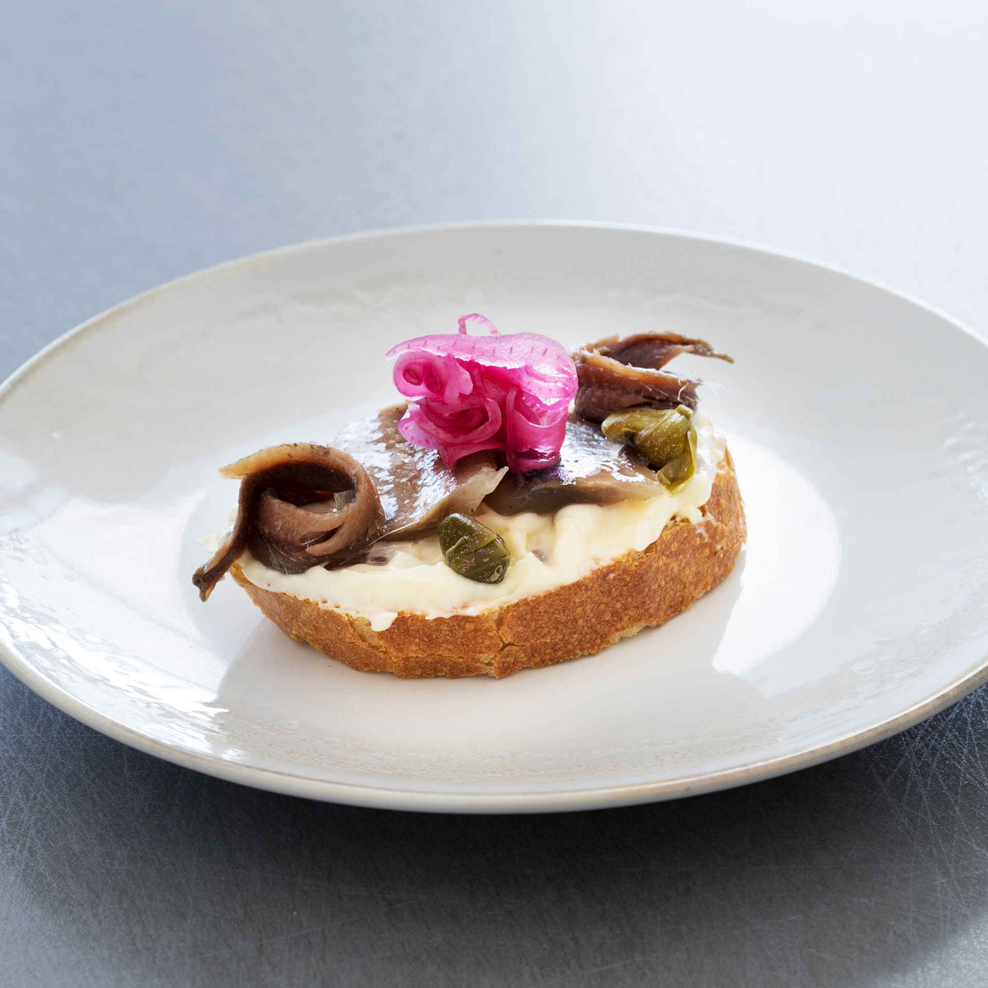Open sandwich with anchovies and herring