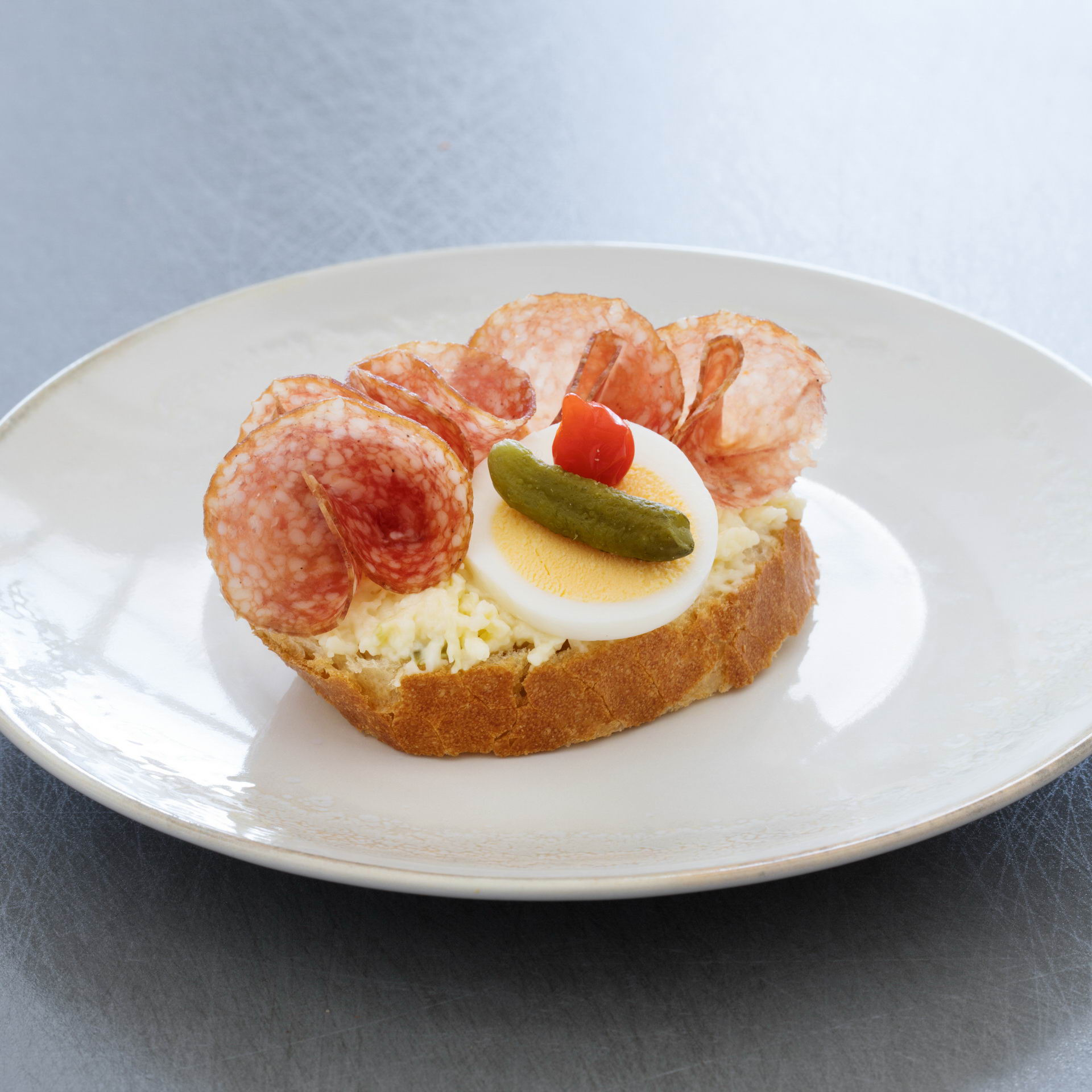 Open sandwich with Hungarian salami