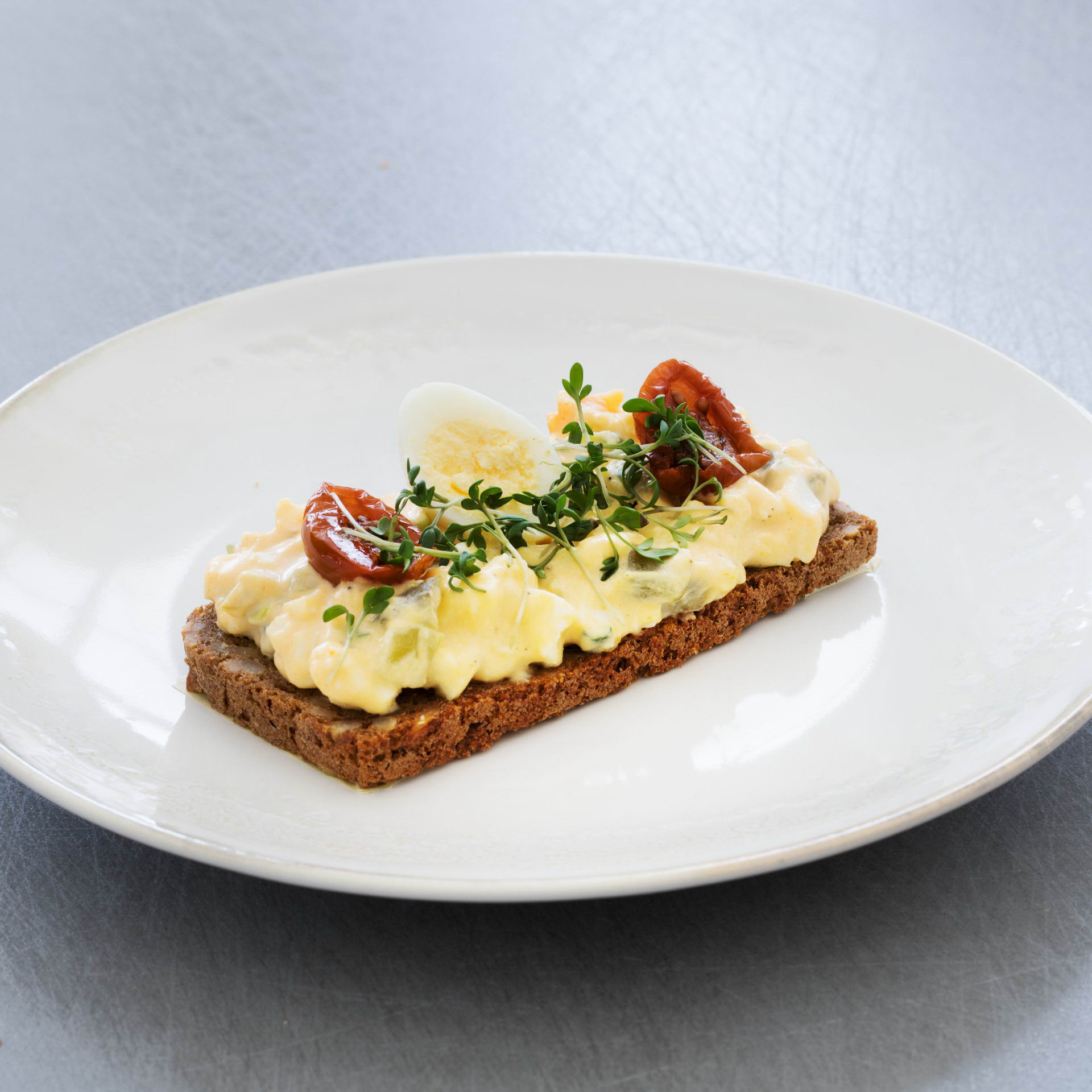 Open sandwich with eggs